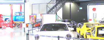 exotic car dealership d box racing simulator draws customers to an exotic car dealership