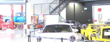 exotic car dealership d box racing simulator draws customers to an exotic car dealership
