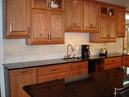 28 small cupboards countertop granite with oak what color light