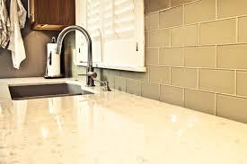 ivory kitchen faucet tiles backsplash black glass countertop adhesive tiles
