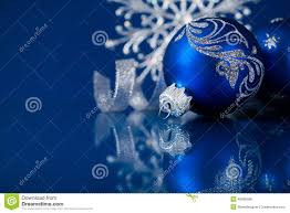 blue and silver christmas ornaments on dark blue background stock