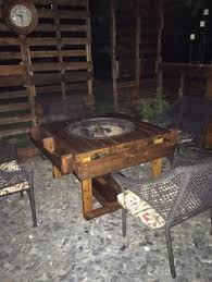 homemade fire pit table diy pallet fire pit table with firewood storage pallet fire pit