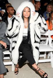 nicki minaj pushes the seasons in 19 000 fur coat at oscar de la