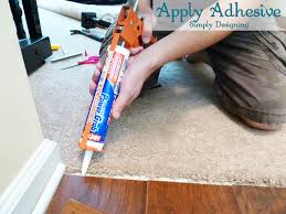apply adhesive for transition strip diy carpet laminateflooring flooring homeimprovement