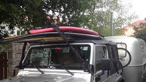surfboard jeep easy modify jeep wrangler to hold sup or kayak with soft top or