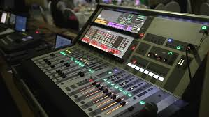 Mixing Table 4k An Audio Engineer Adjusts A Mixer While Doing Live Sound For A