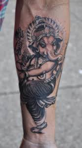 black and grey dancing ganesha tattoo on forearm