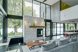 home modern interior design glass lake house features modern silhouette of earthy materials