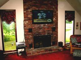 home decor contemporary family room with tv over fireplace and