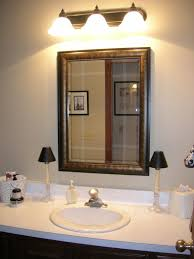 bathroom vanity lights bronze wall led lights above stylish mirror