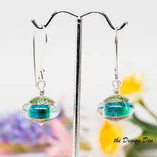 sparkly green earrings sparkly green dichroic earrings the design den