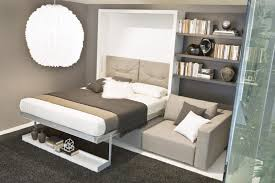 modern white lacquer murphy bed with gray upholstered headboard