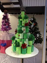 cans covered in green paper stacked to represent a tree