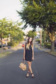black dress and tan accessories in the lensgirl in