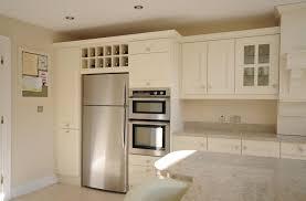 painting kitchen cabinets ireland stunning ivory painted kitchen with kashmir white granite