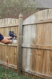 what is the best way to paint wood kitchen cabinets how to paint a wood fence the fast and easy way