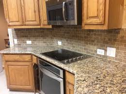 giallo fiorito granite with oak cabinets giallo fiorito granite kitchen traditional with biscuit grout black