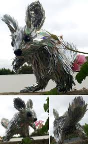 artist turns old cds into amazing sculptures instead of throwing