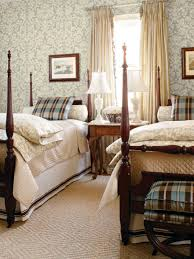 pretty guest bedroom with wallpaper and double beds creative and