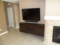 Led Tv Wall Mount With Shelves Furniture Brown Wooden Shelves Under Black Led Tv Having Drawers