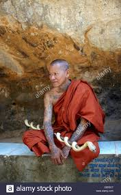 buddhist monk in cambodia with tattoo and shaved head stock photo