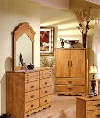 bedroom wardrobe armoire closet design with brown wooden cabinet
