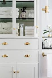 bathroom linen cabinet with glass doors glass front bathroom linen cabinet with polished brass hardware