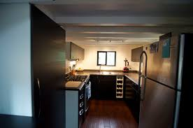 compact kitchen tiny house on wheels