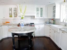 white kitchen black island white kitchen cabinets with glass doors brown laminated