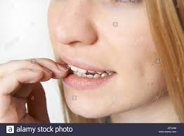 close up of nervous woman biting nails stock photo royalty free