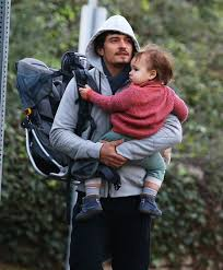 this bundled orlando bloom and baby flynn pic is the best part of