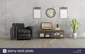 vintage living room with black armchair and old radio on coffee