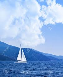 sailboat at open sea beautiful nature background blue color