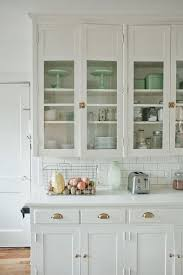 white kitchen cabinet with glass doors pin by shela lyn boxberger on dwell kitchen renovation