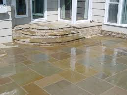 exterior classy white stone tile mosaic flooring patio with green