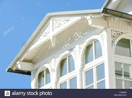 wooden porch of a house in binz with frieze and cornice stock