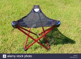 folding portable three legged tripod camping stool with a