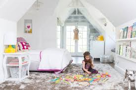 open door policy at home with tiffani thiessen lonny celebrity sloping ceilings nooks for reading and hooks for playing dress up make this