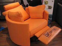 Designer Swivel Chair - fun orange leather on our designer curved swivel rocking electric