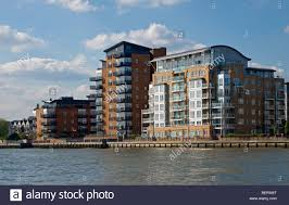 Modern Apartment by Modern Apartment Blocks On The Bank Of The River Thames London