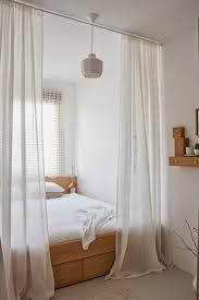 stunning how to hang curtains on a canopy bed images ideas amys