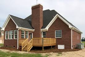 rear deck on red brick home traditional deck raleigh by