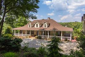 low country style with acres of privacy and stocked lake in