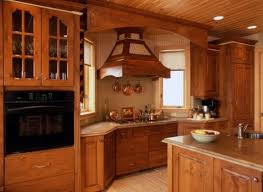 distressed pine kitchen cabinets with copper trimmed hood north