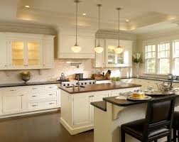 white kitchen cabinets with dark island luxurious home design