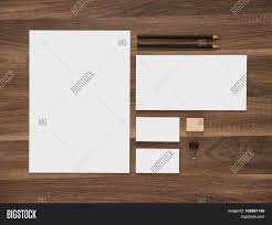 letterhead envelope and blank business cards on wooden desk