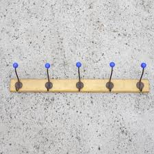vintage coat hook with a natural wooden base u0026 modern blue dots