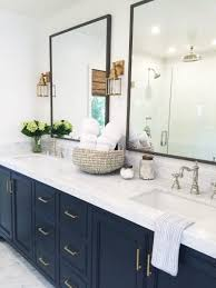 Chic Bathroom Design With White Marble Countertops And Navy - Cabinet designs for bathrooms