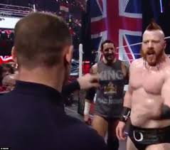 wayne rooney slaps wade barrett at wwe raw after 6ft 7in wrestler