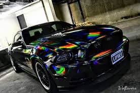 car wrapped in wrapping paper holographic chrome black cws